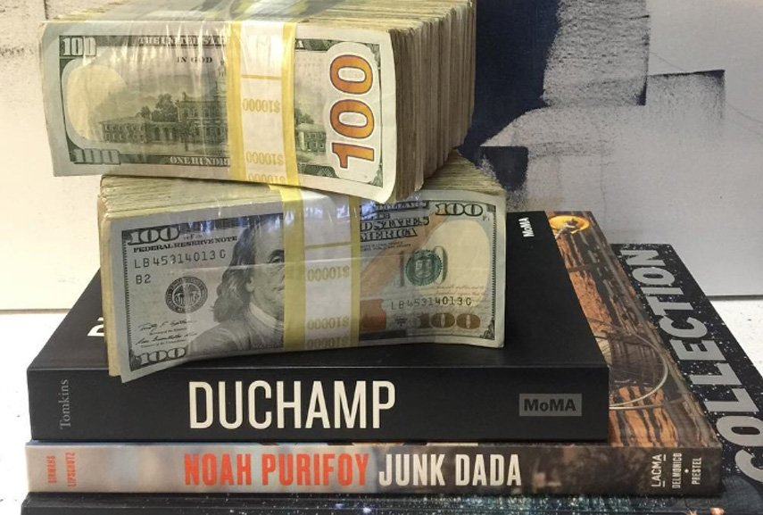 the-most-famous-artist-one-hundred-thousand-dollars-on-instagram-standing-on-top-of-a-book-titled-duchamp-not-a-coincidence